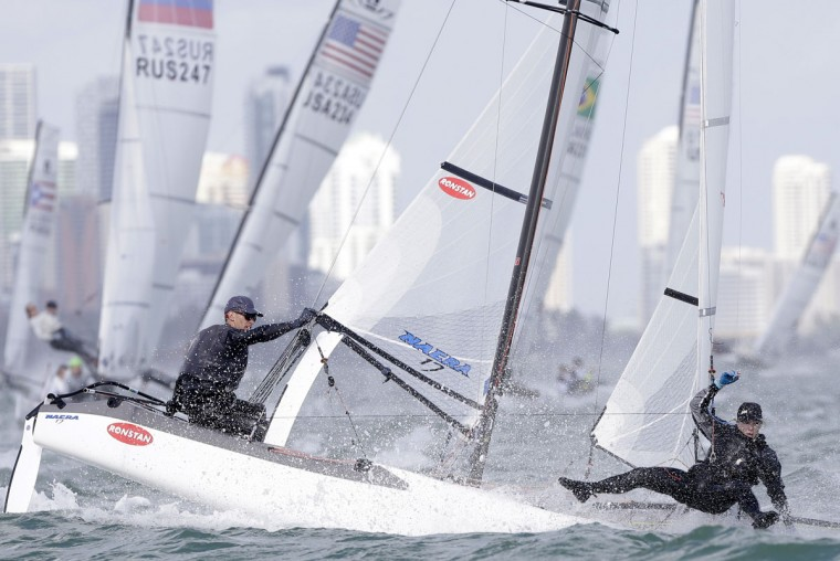 Stephanie Roble, right, falls into the water as she and Tripp Burd, of the USA, compete in the Nacra 17 class during the ISAF Sailing World Cup Miami on Biscayne Bay, Monday, Jan. 26, 2015, in Miami. Sailors from 63 countries are competing in the regatta featuring Olympic and Paralympic class racing. (AP Photo/Lynne Sladky)