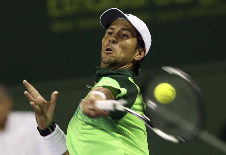 Spain's Fernando Verdasco returns the ball to Russia's Teymuraz Gabashviliduring the Qatar ATP Open Tennis tournament in Doha, Qatar, Monday, Jan. 5, 2015 (AP Photo/Osama Faisal)