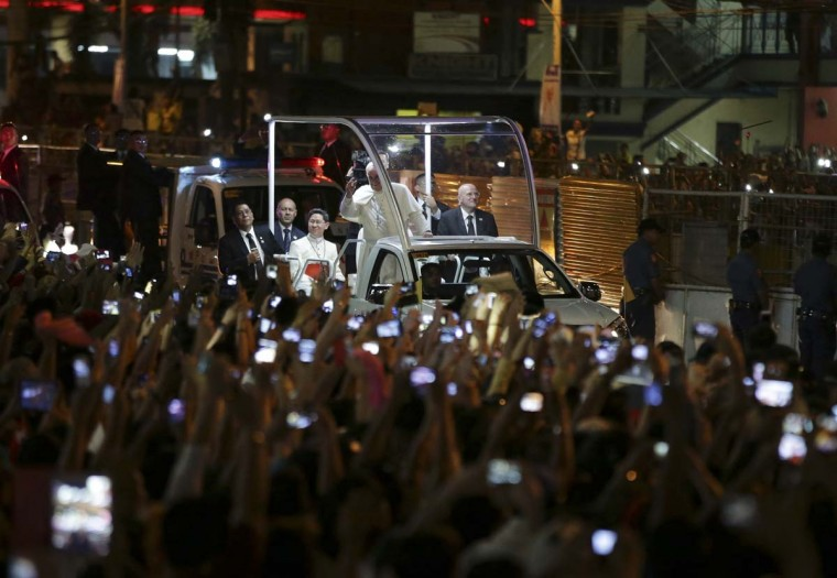 Pope Francis waves to Filipinos upon his arrival in Manila, Philippines Thursday, Jan. 15, 2015. The Pope arrived today for a pastoral visit which is expected to draw millions of faithful where about 81-percent of the population is Catholic. (AP Photo/Aaron Favila)