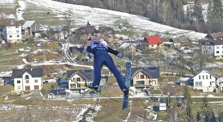 Germany's Severin Freund soars through the air during his trial jump at the 17th World Cup Ski Jumping competition, in Wisla, Poland, Thursday, Jan. 15, 2015. (AP Photo/Alik Keplicz)