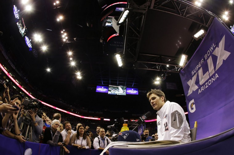 New England Patriots' Tom Brady answers questions during media day for NFL Super Bowl XLIX football game Tuesday, Jan. 27, 2015, in Phoenix. (AP Photo/Charlie Riedel)