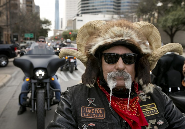 Rocket Navarro rides on Congress Avenue towards the Capitol for the Texas Confederation of Clubs and Independents Legislative Day, Monday, Jan. 26, 2015, in Austin, Texas. Hundreds of bikers from around Texas paraded for motorcycle rights. (AP Photo/Austin American-Statesman, Jay Janner)