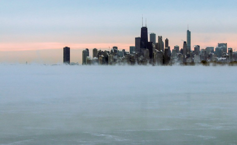 Steam rises over Lake Michigan near the Chicago skyline, Thursday, Jan. 8, 2015. Dangerously cold air has sent temperatures plummeting into the single digits around the U.S., with wind chills driving them even lower. (AP Photo/Teresa Crawford)