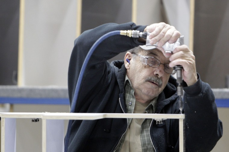 Jim Dykes, of Jackson Center, builds shelves for Airstream travel trailer at the Airstream factory Wednesday, Oct. 22, 2014, in Jackson Center, Ohio. (AP Photo/Jay LaPrete)