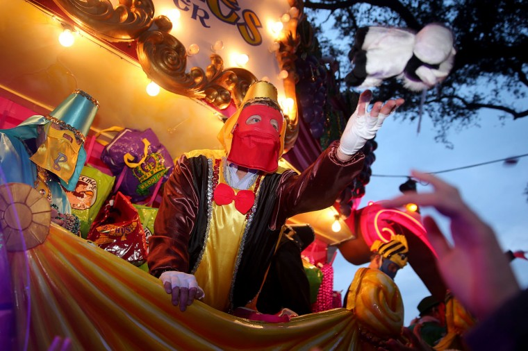 The Krewe of Bacchus, the fourth and largest of Sunday's parades in New Orleans, rolls down the traditional uptown parade route on Sunday, Feb. 15, 2015. (AP Photo/NOLA.com The Times-Picayune, Kathleen Flynn)