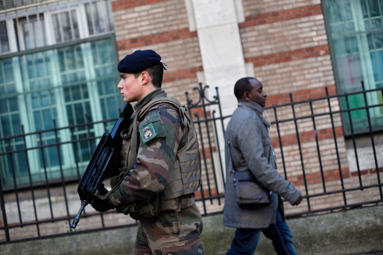 "A French soldier secures the access to a Jewish school in Paris as part of the highest level of ""Vigipirate"" security plan after last week's attacks by Islamist militants, Wednesday, Jan. 14, 2015. France ordered 10,000 troops into the streets Monday to protect sensitive sites ó nearly half of them to guard Jewish schools ó as it hunted for accomplices to the Islamic militants who left 17 people dead as they terrorized the nation. (AP Photo/Thibault Camus)"