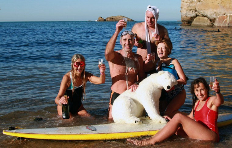Enthusiasts from the long-established swimming club, Les Ours Blancs (The Polar Bears), pose for the camera as they drink champagne during an annual New Year's celebration swim in Biarritz, southwestern France, Thursday, Jan. 1, 2015. (Bob Edme/AP Photo)