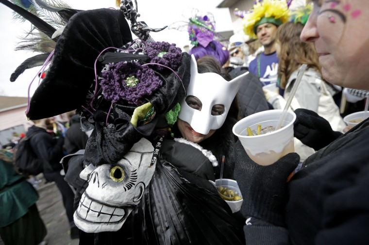 Revelers participate in the Society of Saint Anne parade on mardi Gras day in the Marigny section of New Orleans, Tuesday, Feb. 17, 2015. (AP Photo/Gerald Herbert)