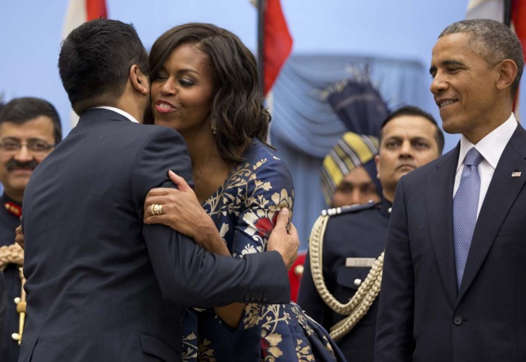 President Barack Obama stands right as first lady Michelle Obama greets Kal Penn during a receiving line with Indian President Pranab Mukherjee before a State Dinner at the Rashtrapati Bhavan, the presidential palace, in New Delhi, India, Sunday, Jan. 25, 2015. Obama's arrival Sunday morning in the bustling capital of New Delhi marked the first time an American leader has visited India twice during his presidency. Obama is also the first to be invited to attend India's Republic Day festivities, which commence Monday and mark the anniversary of the enactment of the country's democratic constitution. (AP Photo/Carolyn Kaster)