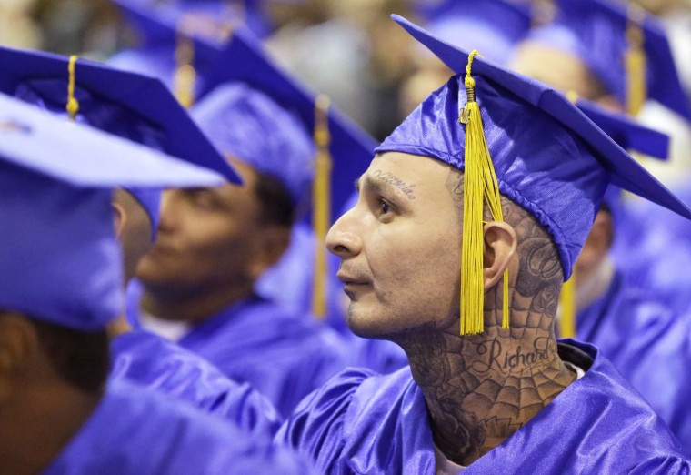 In this photo taken Dec. 12, 2014, prison inmate Richard Chavez sits with classmates and listens to a speaker during graduation ceremonies at the Cleveland Correctional Facility in Cleveland, Texas. (AP Photo/Pat Sullivan)