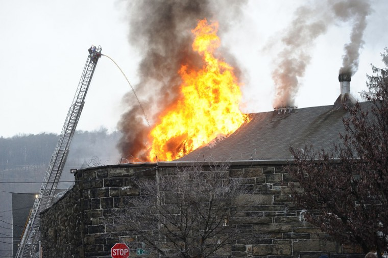 Flames shoot through the roof of the Northumberland County Prison in Sunbury, Pa., Wednesday, Jan. 14, 2015. The blaze was reported just after 2 p.m. at the nearly 140-year-old jail in the city of 10,000 about 40 miles north of Harrisburg, Pa. (AP Photo/The News-Item, Larry Deklinski)
