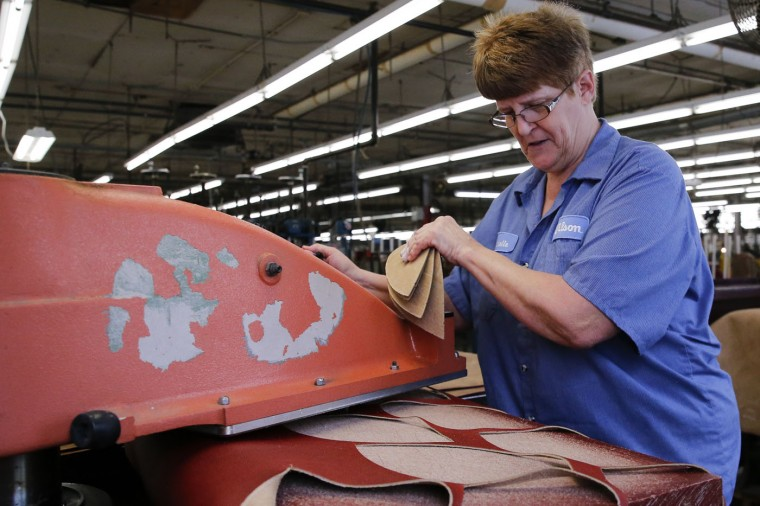 Michelle Burkett cuts panels for an official game ball for the NFL football Super Bowl XLIX at the Wilson Sporting Goods Co. in Ada, Ohio, Tuesday, Jan. 20, 2015. The New England Patriots will play the Seattle Seahawks in the Super Bowl on Feb. 1 in Glendale, Arizona. (AP Photo/Rick Osentoski)