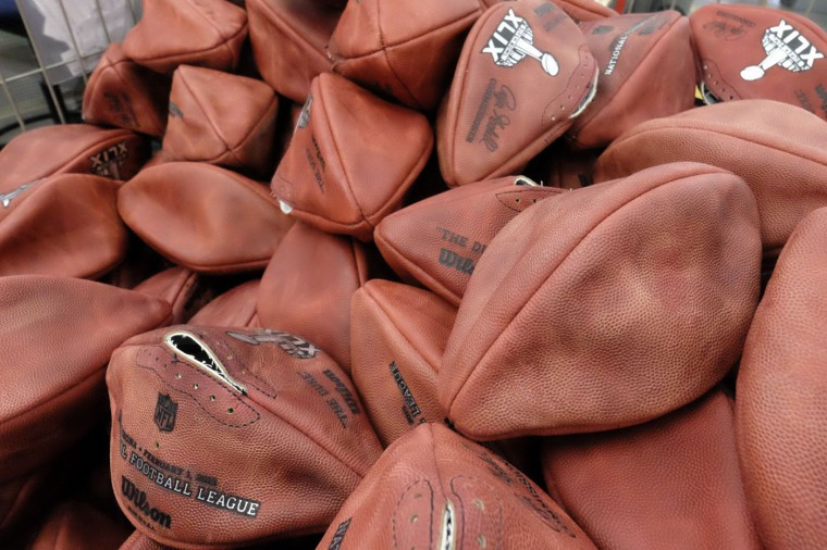 Official game balls for the NFL football Super Bowl XLIX wait for final assembly at the Wilson Sporting Goods Co. in Ada, Ohio, Tuesday, Jan. 20, 2015. The New England Patriots will play the Seattle Seahawks in the Super Bowl on Feb. 1 in Glendale, Arizona. (AP Photo/Rick Osentoski)
