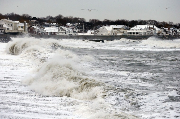 Ocean waves continue to come ashore a day after a winter storm in Scituate, Mass., Wednesday, Jan. 28, 2015. The storm buried the Boston area in more than 2 feet of snow and lashed it with howling winds that exceeded 70 mph. (AP Photo/Michael Dwyer)