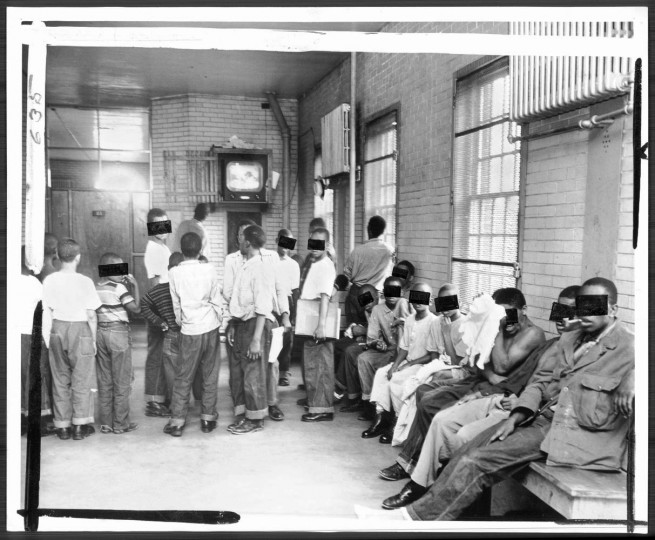 Young boys in the building watch a television program in their dayroom. Continuous television considered doubtful therapy for them but better than no therapy.