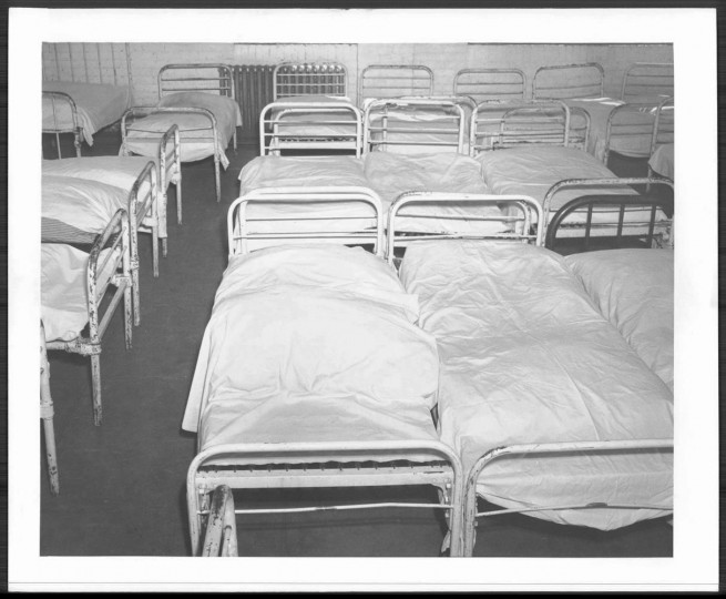 Cots are close together and also isle are very narrow. Men must climb over one another to get in and out of bed. Photo by Ralph Dohme
