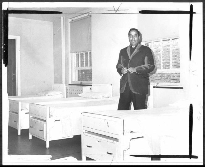 Father Cecil Marshall Stands in one of the dormitories in the adolescent unit. Photo taken August 11, 1967.