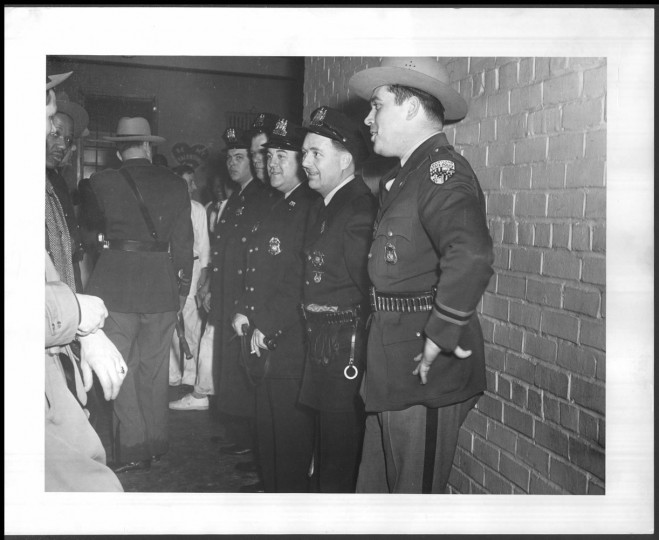 Police line the corridor after riots in 1953. Photo taken Feb. 10, 1953.