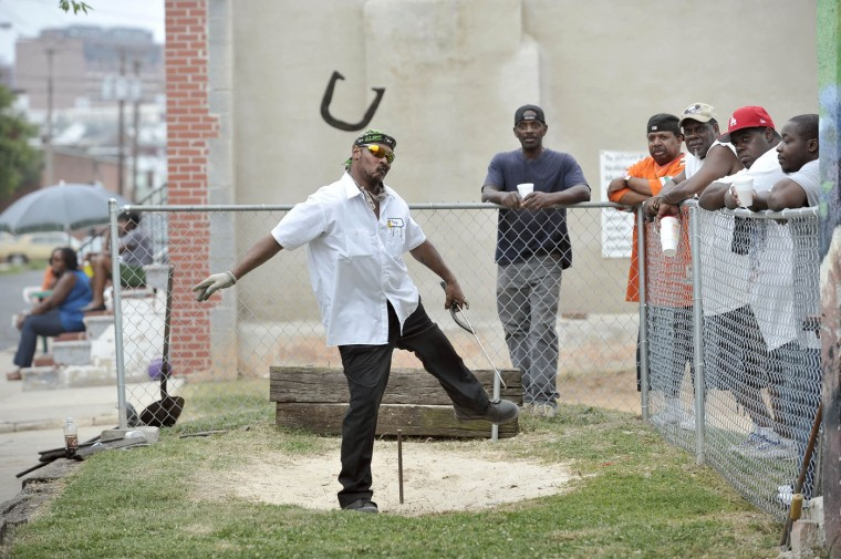 6/25/11: Tony Ashton, Kingston, pitches a horseshoe in the opening match of the 1st Annual Horseshoe Tournament at the Pit in Pigtown. The event celebrates the preservation of the pit by Baltimore Green Space. Kim Hairston/Baltimore Sun