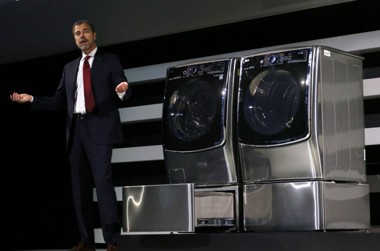 David VanderWaal, LG Electronics USA, introduces the new LG TWIN Wash System with a first-of-its-kind mini washer in the pedestal during a news conference at the 2015 International CES on Monday, Jan. 5, 2015, in Las Vegas. (Photo by Jack Dempsey/Invision for LG/AP Images)