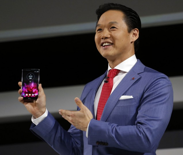 Frank Lee, LG MobileComm USA, unveils the new G Flex2 smartphone during a news conference at the 2015 International CES on Monday, Jan. 5, 2015, in Las Vegas. It is the first phone to be available with a Snapdragon 810 processor. (Photo by Jack Dempsey/Invision for LG/AP Images)