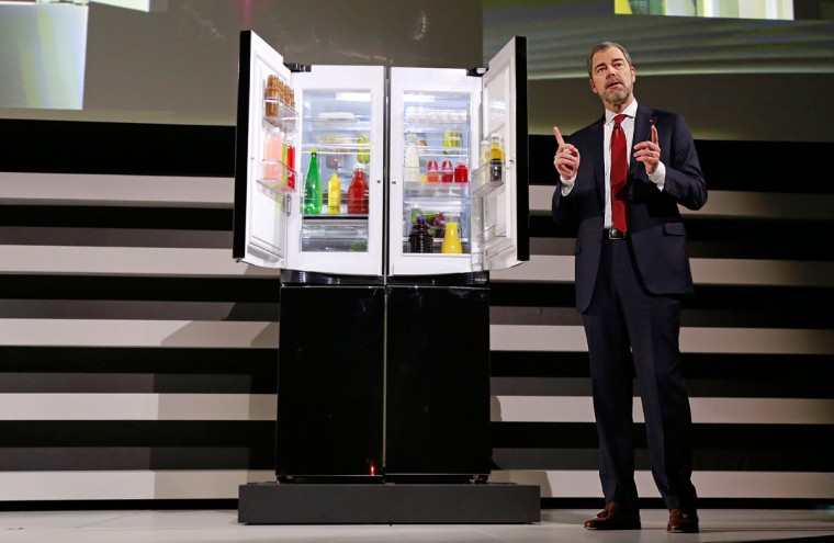 David VanderWaal, LG Electronics USA, unveils the first-of-its-kind Double Door-in-Door refrigerator during a news conference at the 2015 International CES on Monday, Jan. 5, 2015, in Las Vegas. (Photo by Jack Dempsey/Invision for LG/AP Images)