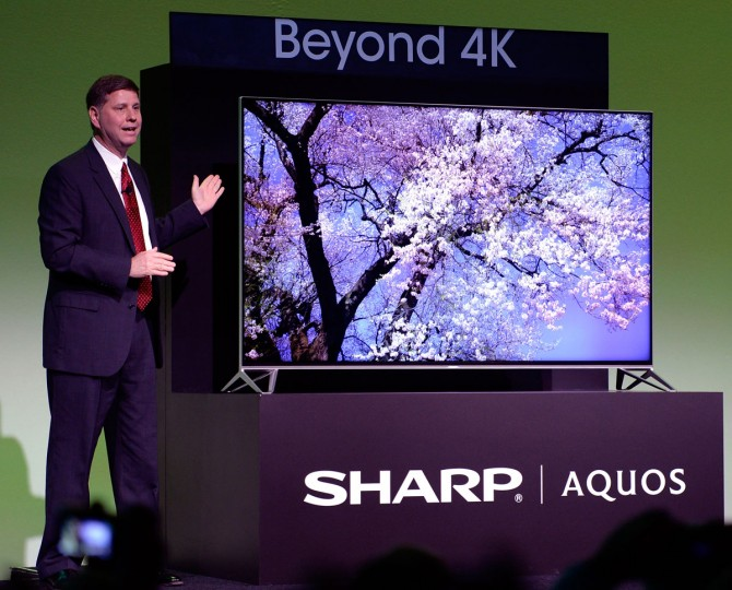 Jim Sanduski, President of Sharp Electronics Marketing Company of America, unveils the Beyond 4K Ultra HD TV, the highest resolution TV, on stage at Sharp's 2015 Consumer Electronics Show press conference on Monday, January 5, 2015 in Las Vegas. The television combines Sharp's proprietary pixel splitting and Quattron™ technologies, resulting in 66 million subpixels, 42 million more than standard 4K Ultra HD. (Jeff Bottari/AP Images for Sharp USA)
