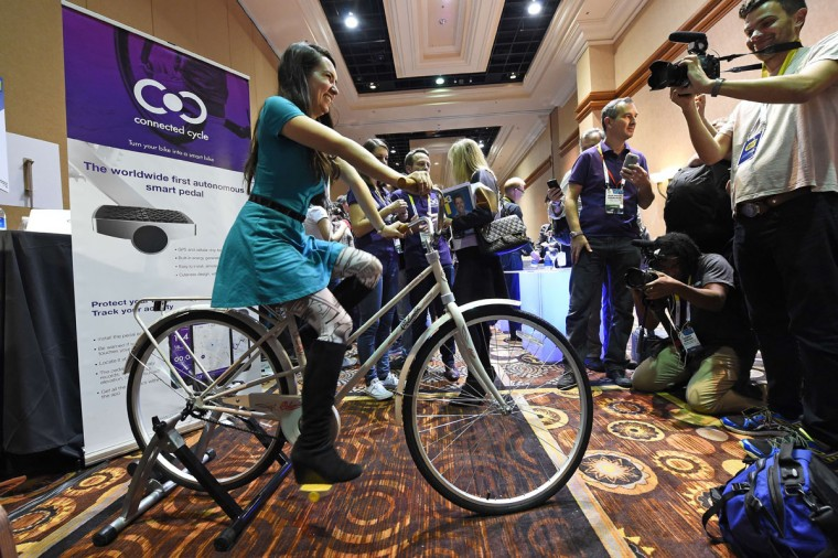 An attendee rides a bicycle equipped with a yellow Connected Cycle smart pedal. The Connected Cycle pedal is equipped with GPS and GPRS sensors that are powered by cycling and can help locate a bicycle in case of theft. When the pedal moves sensors track the users activity tracking training information by recording speed, route, incline, and calories burned. Connected Cycles pedal has GPS and connects to a cloud platform giving the owner information of the bikes location in case of theft. (ROBYN BECK/AFP/Getty Images)