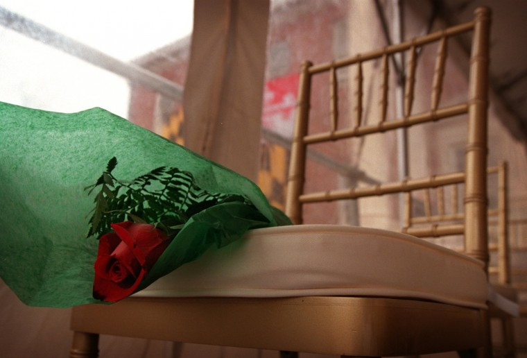 A single rose sits on a chair in remembrance of Gov. Parris Glendening's brother Bruce at the State House in Annapolis on the Governor's Inauguration Wed., Jan. 20, 1999. Bruce apparently died of AIDS, and Glendening mentioned him and the parents of his wife Frances, who were honored with roses as well. (Baltimore Sun/Karl Merton Ferron)