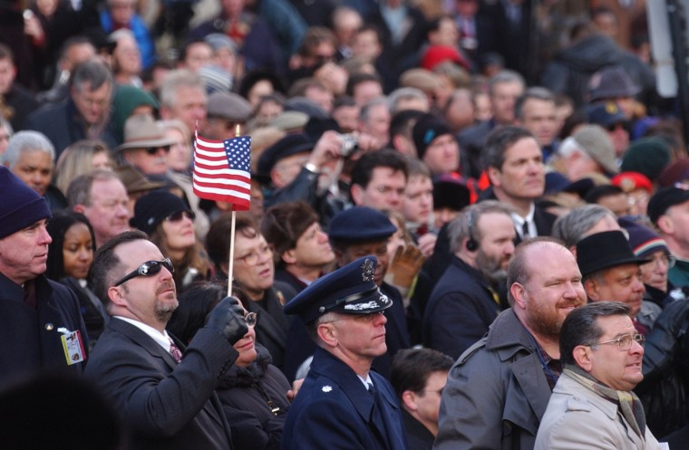 A supporter waves a the U.S. flag during Governor Ehrlich's inauguration ceremony on the steps of the State House in 2003. (John Makely, Baltimore Sun file photo)