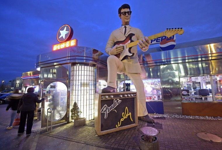 A big Buddy Holly statue invites guests to an American diner restaurant in the city of Essen, Germany, Thursday, Jan. 15, 2015. (AP Photo/Martin Meissner)