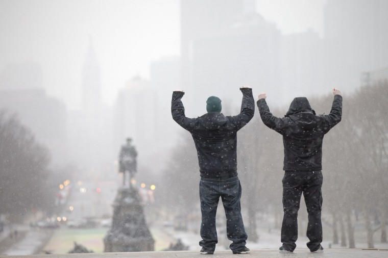 "During a winter storm tourists imitate the character Rocky Balboa from the 1976 movie ""Rocky,"" on the steps of the Philadelphia Museum of Art, Wednesday, Jan. 21, 2015, in Philadelphia. (AP Photo/Matt Rourke)"