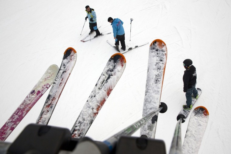In this photo taken Saturday, Jan. 24, 2015, skiers take to the slopes of Nanshan ski resort in Beijing. As Beijing makes a final push in its bid for the 2022 Winter Olympics, Chinese President Xi Jinping says winning the bid will encourage over 300 million Chinese to take up winter sports by 2022, according to state-run Xinhua News agency. (AP Photo/Ng Han Guan)