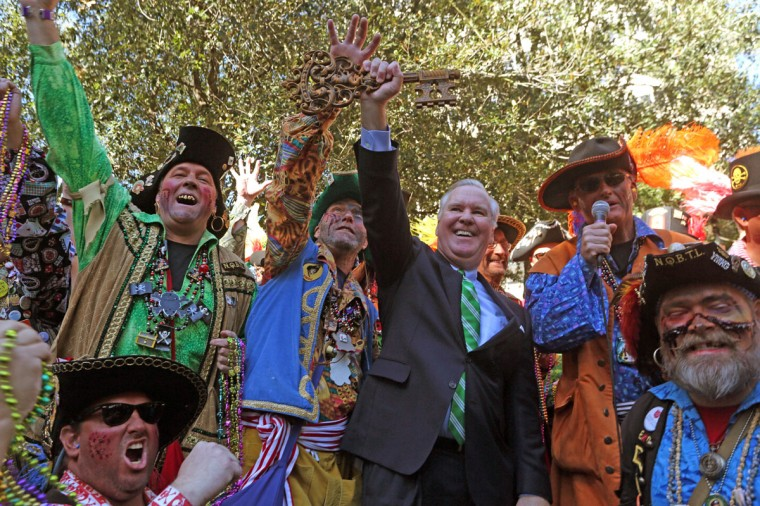 Ye Mystic Krewe pirates stand with Mayor Bob Buckhorn as he holds the key to the city in Tampa, Tuesday, Jan. 27, 2015. (AP Photo/The Tampa Bay Times, Skip O'Rourke)