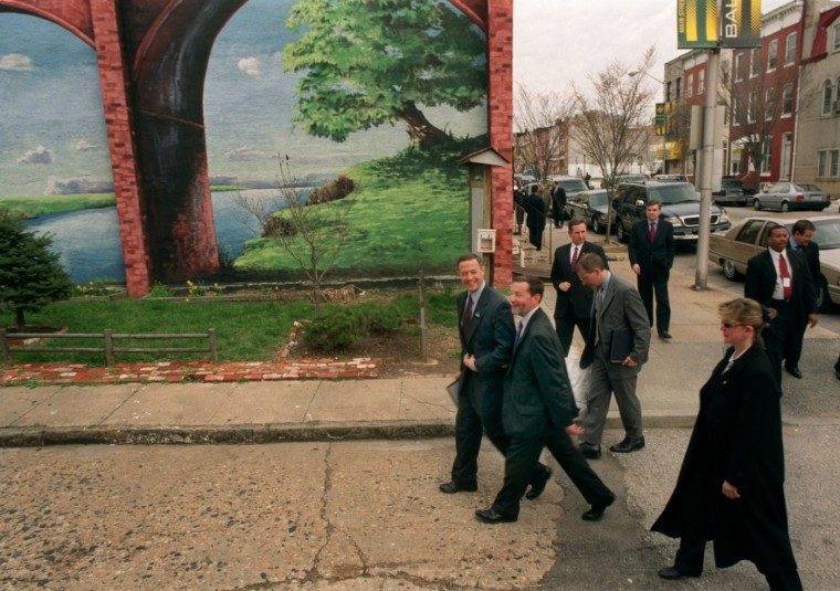4/1/2003: British Home Secretary David Blunkett , the English equivalent of John Ashcroft and Tom Ridge rolled into one, is escorted by Mayor Martin O'Malley to Washington Village Community Association on Washington Blvd., in Pigtown. to talk homeland security and tour a real Baltimore neighborhood. Jed Kirschbaum/Baltimore Sun
