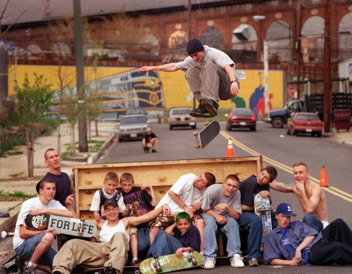 4/6/00-- Drivers along James St. in Pigtown wait patiently while Chris Kramer jumps over fellow SFPs (skaters from Pigtown). The skaters block off one lane of the road and set up homemade ramps. Elizabeth Mably/Baltimore Sun