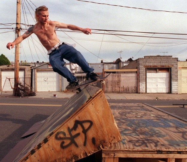 4/6/00-- Bobby Starr jumps over a homemade ramp along James St. in Pigtown where SFPs (skaters from Pigtown) block off one lane of the road and set up the ramps. Elizabeth Mably/Baltimore Sun