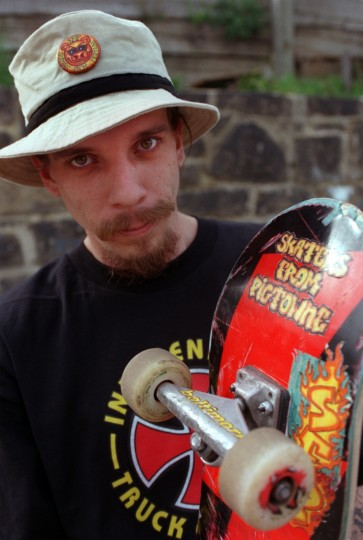 4/6/00-- Longtime skater Ed Batz makes stikers for fellow skaters from Pigtown with his SFP logo. The skaters block off one lane of James St. in Pigtown and set up homemade ramps. staff Elizabeth Mably/Baltimore Sun