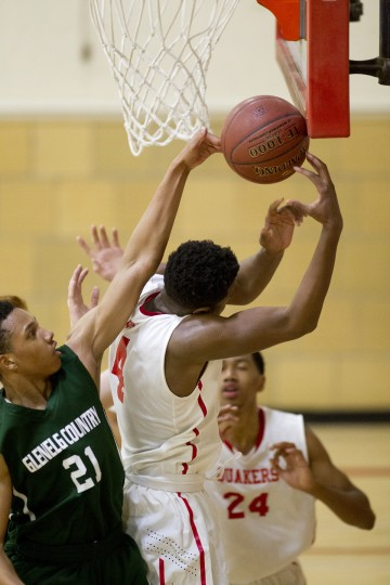 Glenelg Country School's C.J. Wilson, left, and Friends School's Myles Douglas, right, during the boys basketball game at Friends School in Baltimore, MD on Thursday, January 8, 2015. (Jen Rynda/BSMG)