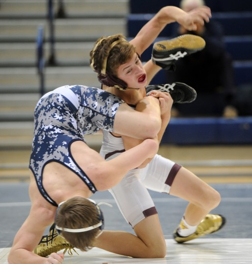 Havre de Grace's Alex Lloyd battles Bel Air opponent in the David Reagan during Wednesday afternoon's meet at Bel Air. (Matt Button/BSMG)