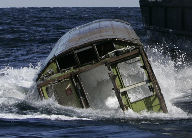 Water surges into an old New York City subway car which sinks in the Atlantic Ocean off the coast of Delaware, Tuesday, Oct. 7, 2008. The subway cars are used to form an underwater reef which is a habitat for all kinds of sea creatures and vegetation. (AP Photo/Mike Derer)