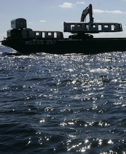 An old New York City subway car is dropped from a barge into the Atlantic Ocean off the coast of Delaware, Tuesday, Oct. 7, 2008. The subway cars are used to form an underwater reef which is a habitat for sea creatures. (AP Photo/Mike Derer)