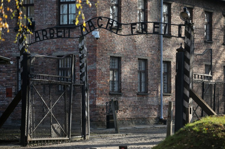 The infamous German inscription that reads 'Work Makes Free' at the main gate of the Auschwitz I extermination camp on November 11, 2014 in Oswiecim, Poland. (Photo by Christopher Furlong/Getty Images)