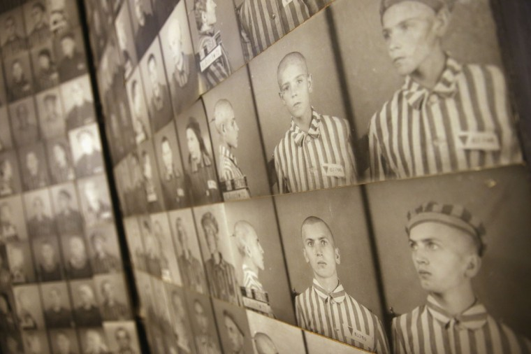 Photos of Auschwitz inmates hang on a wall at the former Auschwitz I concentration camp, which today is a museum, on January 25, 2015 in Oswiecim, Poland. International heads of state, dignitaries and over 300 Auschwitz survivors will commemorate the 70th anniversary of the liberation of Auschwitz by Soviet troops in 1945 on January 27. (Photo by Sean Gallup/Getty Images)