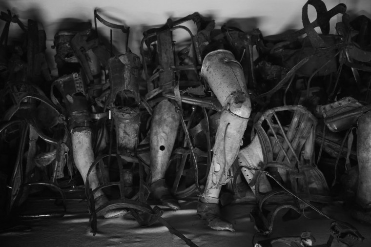 Prosthetic limbs confiscated from Auschwitz prisoners lie in an exhibition display at the former Auschwitz I concentration camp, which today is a museum, on January 25, 2015 in Oswiecim, Poland .(Photo by Sean Gallup/Getty Images)