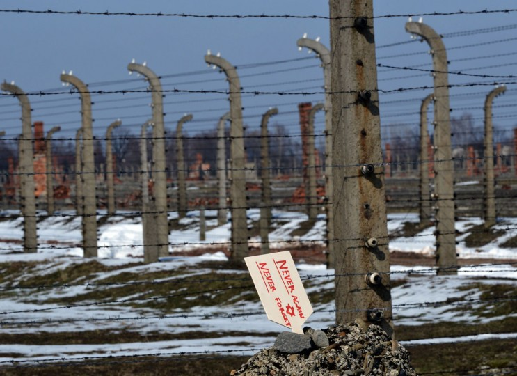 A picture taken on April 8, 2013 shows a memory plaque stuck into a pile of pebbles on the barbed wired premises of the KZ Auschwitz-Birkenau concentration camp, in Oswiecim, Poland to commemorate the six million Jews killed during the Holocaust. (JANEK SKARZYNSKI/AFP/Getty Images)