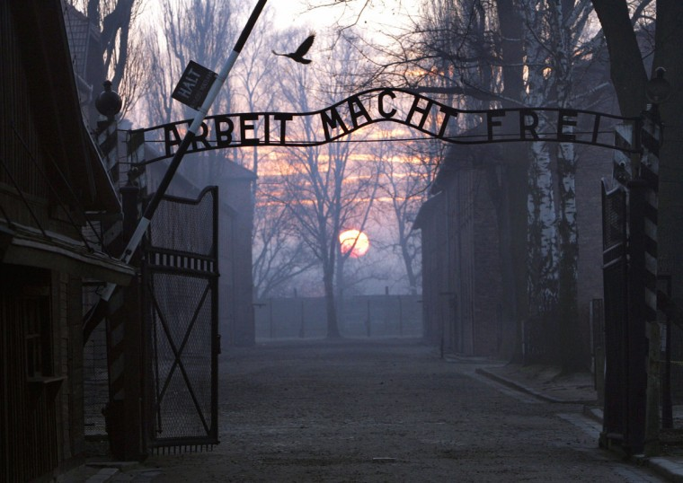 This photo taken on January 13, 2005 shows the main gate entering the Nazi Auschwitz death camp at sunrise. Poland marks on January 27, 2015 70 years since the Soviet Red Army liberated Auschwitz, the largest German death camp, in what is now southern Poland. (JANEK SKARZYNSKI/AFP/Getty Images)