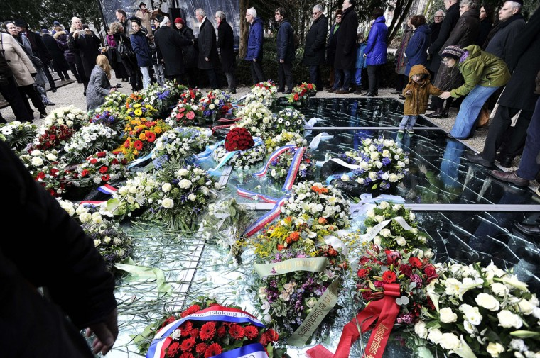 Flowers are laid at the Auschwitz monument in the Wertheimpark in Amsterdam, on January 25, 2015, as part of the International Holocaust Remembrance Day (Yom HaShoah) which will be held on January 27. (EVERT ELZINGA/AFP/Getty Images)