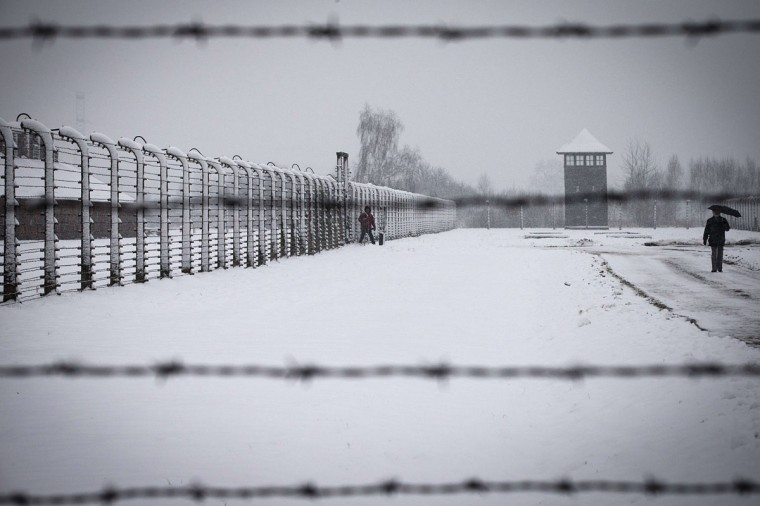 Visitors walk through snow at the memorial site of the former Nazi concentration camp Auschwitz-Birkenau in Oswiecim, Poland on January 25, 2015, days before the 70th anniversary of the liberation of the camp by Russian forces. (JOEL SAGET/AFP/Getty Images)