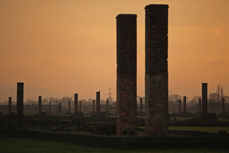 The sun rises over chimneys and the remains of detention blocks at the Auschwitz II Berkenau extermination camp on November 11, 2014 in Oswiecim, Poland. (Photo by Christopher Furlong/Getty Images)